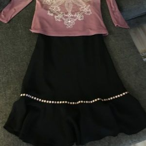 Black skirt with pink ribbon